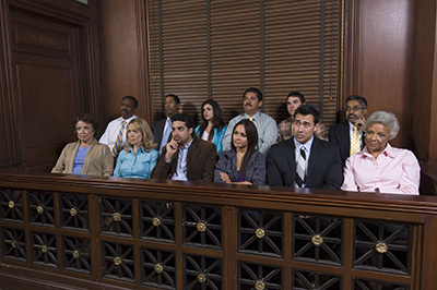 Group of multiethnic business people sitting together in court room